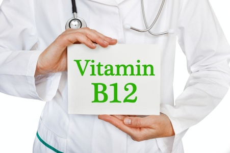 The female doctor, with the plate Vitamin B12,  medical concept